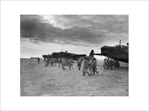 Aircrews of No. 149 Squadron RAF approach a line of Vickers Wellington Mark IAs at Mildenhall, Suffolk for an early morning training sortie.   The Squadron's operations at this time were directed mostly against German naval installations and shipping.