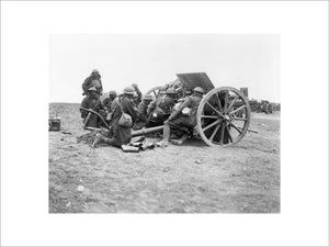 A battery of 18-pounder field guns of the Royal Field Artillery in action near the town of Albert on the Somme, 28 March 1918.