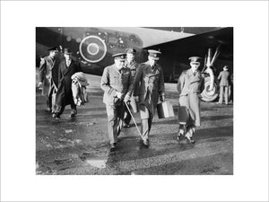 "The Prime Minister, Winston Churchill in RAF uniform, accompanied by Air Chief Marshal Sir Charles Portal, Chief of the Air Staff, leaving Consolidated Liberator ""Commando"" of No. 24 Squadron RAF at Lyneham, Wiltshire, on their return from the Casablanca"