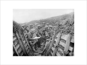 Officers of 1/7th Battalion, King's Liverpool Regiment checking a map in trenches of the La Bassee Canal sector, 28 February 1918.
