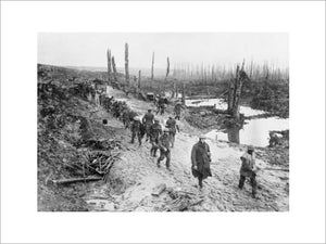 British troops of the 17th Battalion, London Regiment, 47th Division, crossing a muddy area in the Ancre Valley, Somme, October 1916.