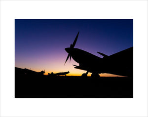Supermarine Spitfire at the Duxford Airfield during sunrise