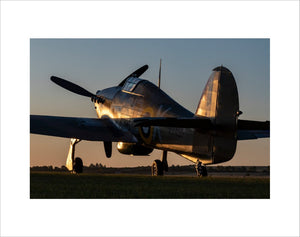 Hawker Hurricane sits at the Duxford Airfield during sunrise