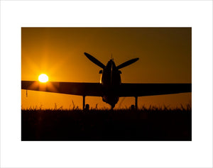 Hawker Hurricane moving to the runway at the Duxford Airfield during sunrise