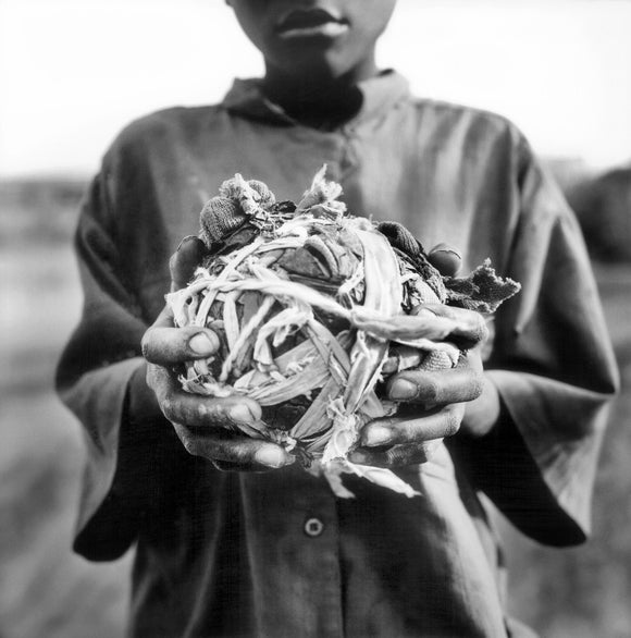Homemade football. Kuito, Angola. 2002.