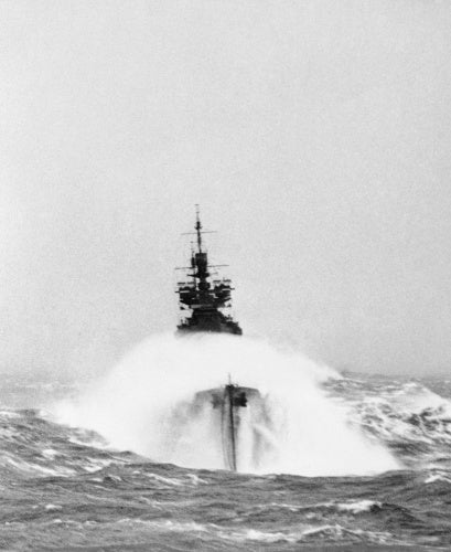 The battleship HMS DUKE OF YORK in heavy seas on a convoy escort operation to Russia, March 1942.