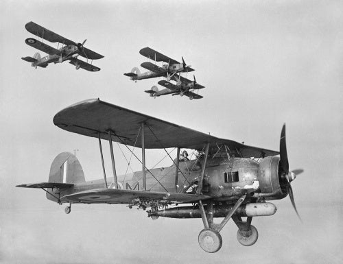 Fairey Swordfish Mk I torpedo bombers of the Fleet Air Arm on a training flight from Crail in Scotland, 1940.