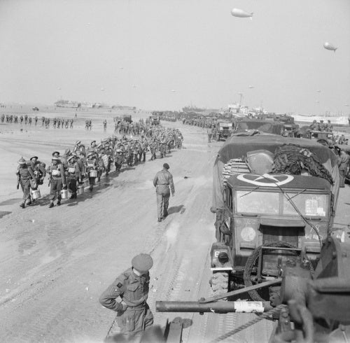 Troops and transport of British 50th Division on the Normandy beaches, 7 June 1944.