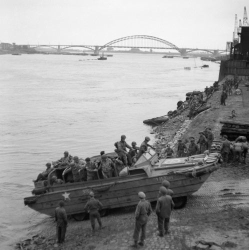 A British DUKW carries supplies and American paratroopers across the Waal river at Nijmegen, 30 September 1944.