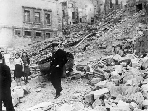 Winston Churchill inspecting air raid damage in the dockyard area of Valletta, Malta, 19 November 1943.