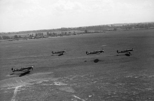 Supermarine Spitfire Mk VBs of No. 122 Squadron RAF take off from Hornchurch, Essex, for a fighter sweep over France, May 1942.