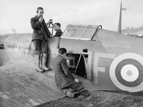Radio mechanics testing the VHF transmitter/receiver in a Hawker Hurricane Mk I of No. 601 Squadron RAF at Exeter, Devon, November 1940.