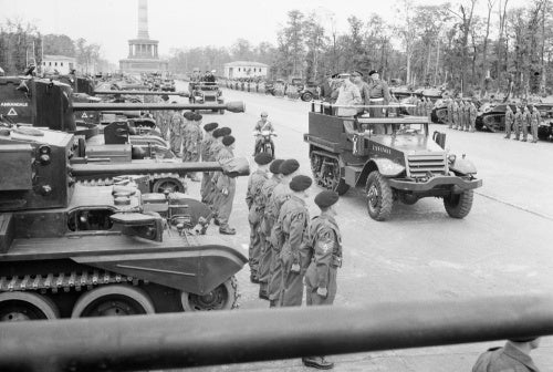 Winston Churchill, accompanied by Field Marshal Sir Bernard Montgomery and Field Marshal Sir Alan Brooke, inspects tanks of 7th Armoured Division in Berlin, 21 July 1945.