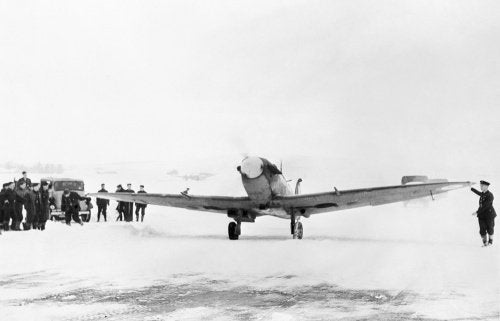 Supermarine Spitfire of No. 603 Squadron taxiing out at Dyce in Scotland for another routine convoy patrol, 4 February 1942.