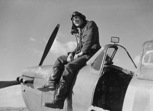 Flying Officer Leonard 'Ace' Haines of No. 19 Squadron on his Supermarine Spitfire Mk I at Fowlmere near Duxford, September 1940.