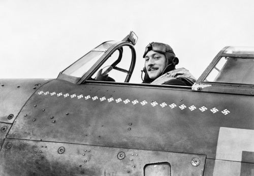 Squadron Leader Robert Stanford Tuck, commanding No. 257 Squadron, in the cockpit of his Hawker Hurricane at Martelsham Heath, November 1940.