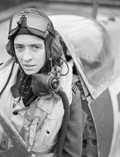 Wing Commander Richard 'Dickie' Milne in the cockpit of his Spitfire Mk IX at Biggin Hill, February 1943.