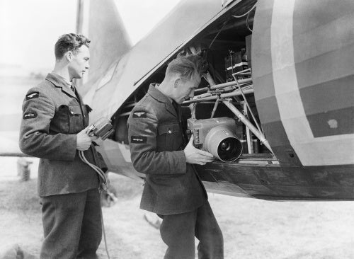 Groundcrew installing a Type F.24 camera into a Westland Lysander Mk II of No. 225 Squadron at RAF Tilshead, Wiltshire, September 1940.
