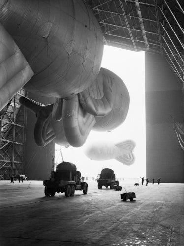 RAF kite balloons are walked out of No. 1 Airship Shed at Cardington for handling practice by No. 1 Balloon Training Unit, October 1940.