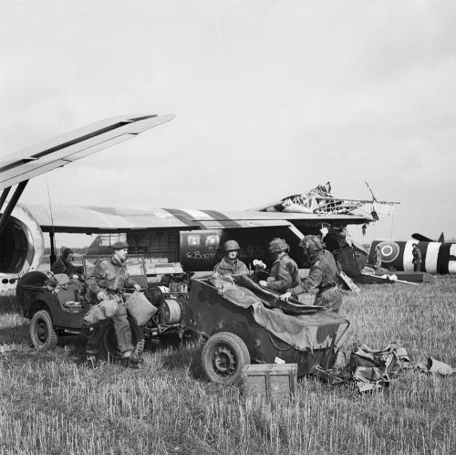 HQ of 1st Airlanding Light Regiment, Royal Artillery, unload a jeep and trailer from their Horsa glider at the landing zone near Wolfheze in Holland, during Operation 'Market Garden', 17 September 1944.