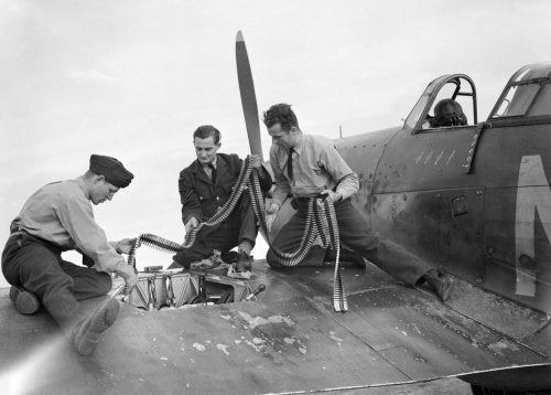 Armourers replenish the ammunition in a Hawker Hurricane Mk I of No. 310 (Czechoslovak) Squadron RAF at Duxford, Cambridgeshire, 7 September 1940.