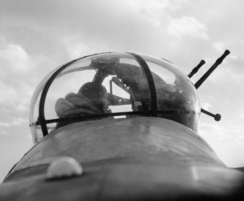 A No. 57 Squadron Lancaster mid-upper gunner in his turret, February 1943.
