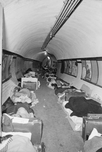 Londoners sleeping in the passageway of a London Underground station, probably Aldwych, in November 1940.