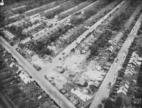 The damage caused by a German V-2 rocket which exploded at the junction of Wanstead Park Road and Endsleigh Gardens in Cranbrook, Ilford, on 8 March 1945.