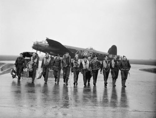Aircrew of No. 106 Squadron photographed in front of a Lancaster at Syerston, Nottinghamshire, on the morning after the raids on Genoa, 22-23 October 1942.