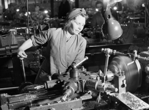 Mrs D Cheatle from Sheffield operating a capstan lathe at a munitions factory in Yorkshire during 1942.