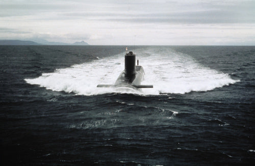 HMS RESOLUTION, the first nuclear-powered ballistic missile submarine to be equipped with Polaris missiles, seen underway on the surface probably off the Scottish coast c. 1970.