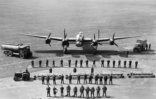 A graphic line-up of all the personnel required to keep one Avro Lancaster of RAF Bomber Command flying on operations, taken at Scampton, Lincolnshire, 11 June 1942.
