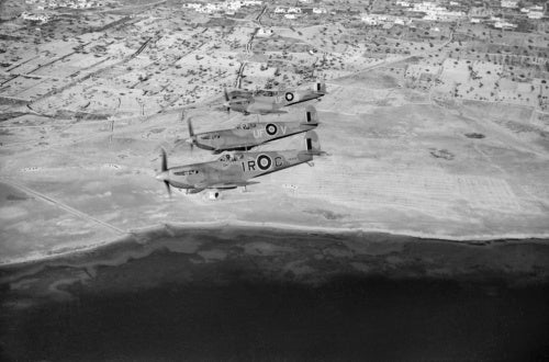 Spitfire LF Mk Vs of No. 244 Wing flying over the Tunisian coast after escorting light bombers on a sortie to Mareth, 23 March 1943.