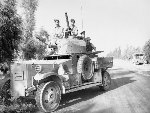A Fordson Armoured Car of No. 2 Armoured Car Company RAF waits outside Baghdad, while negotiations for an armistice take place between British officials and the rebel government during the Iraqi Revolt, May 1941.