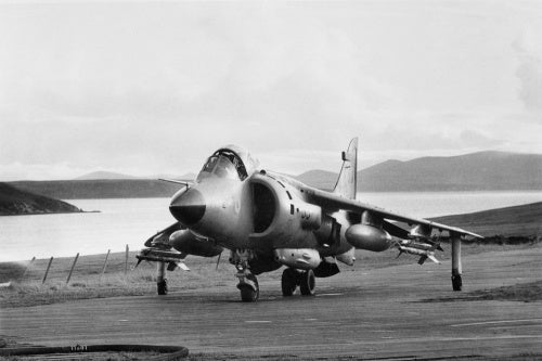 A Sea Harrier on the temporary airstrip constructed at San Carlos on the Falkland Islands, named HMS SHEATHBILL, June 1982.