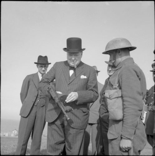 Winston Churchill holds a 'Tommy gun' during an inspection of invasion defences near Hartlepool, 31 July 1940.