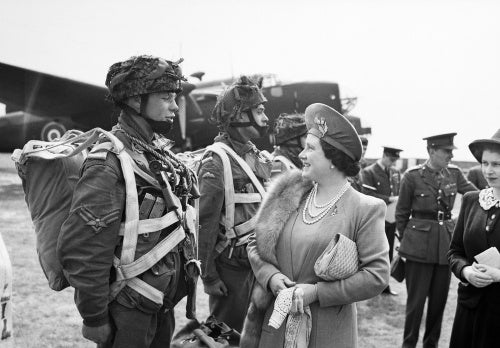 The Queen and Princess Elizabeth talk to paratroopers in front of a Halifax aircraft during a tour of airborne forces preparing for D-Day, 19 May 1944.
