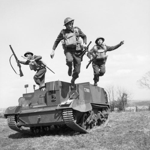 Troops of the 2nd Monmouthshire Regiment leap from their Universal carrier during an exercise near Newry in Northern Ireland, 26 April 1941.