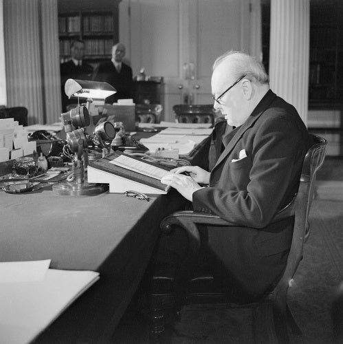 Winston Churchill at the microphone in the Cabinet Office, making his 'VE Day' broadcast to the nation, 8 May 1945.