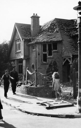 A bomb-damaged house in Gosport after a German air raid on 12 August 1940.