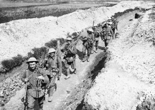 Men of the King's Liverpool Regiment carrying barbed wire picket posts along a communication trench near Blairville Wood, 16th April 1916.