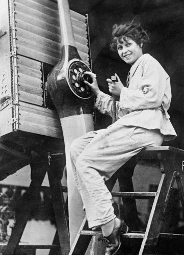 A member of the Women's Royal Air Force (WRAF) working on the propellor of an Airco DH9A in 1918.