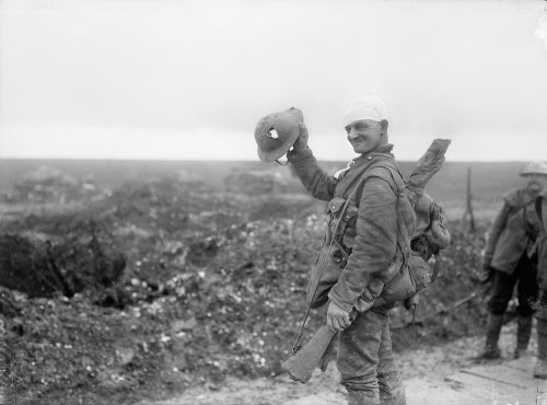 Wounded British soldier showing shrapnel damage to his steel helmet caused near Hamel on the Somme Front in December 1916.
