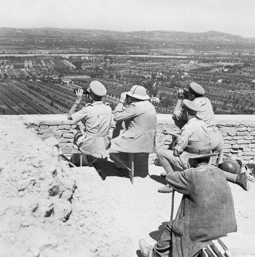 Winston Churchill and General Sir Harold Alexander watching an attack on a German-held ridge in Italy, 26 August 1944.