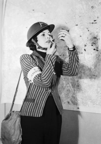A female member of Air Raid Precautions staff applies her lipstick between emergency calls.