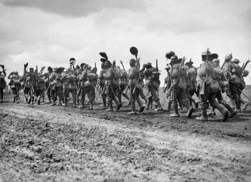Ernest Brooks: Men of the Wiltshire Regiment waving their helmets as they march along the Acheux road to the trenches.