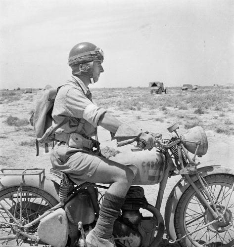 Western Desert:  An Army despatch rider on his machine in the desert