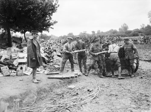 Gunners of the Royal Field Artillery loading 18-pounder shells into limbers. Acheux, Somme, July 1916.