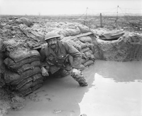 A sergeant of the Lancashire Fusiliers in a flooded dugout opposite Messines near Ploegsteert Wood, January 1917.