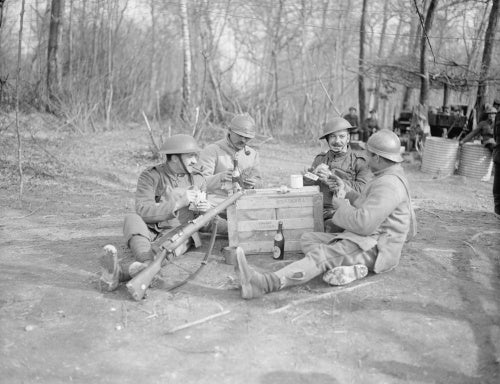 French and British soldiers playing cards together at Bernagousse, 16 March 1918.
